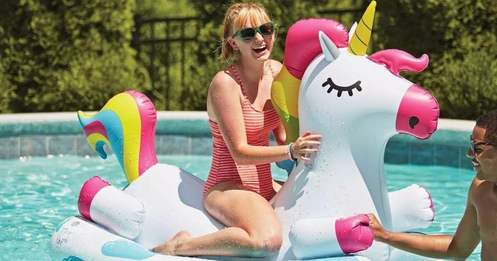 woman on a unicorn pool float