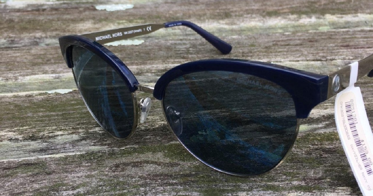 pair of black sunglasses resting on a wooden surface