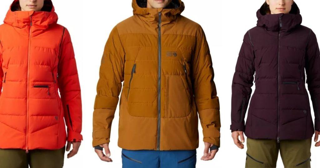 three people wearing jackets