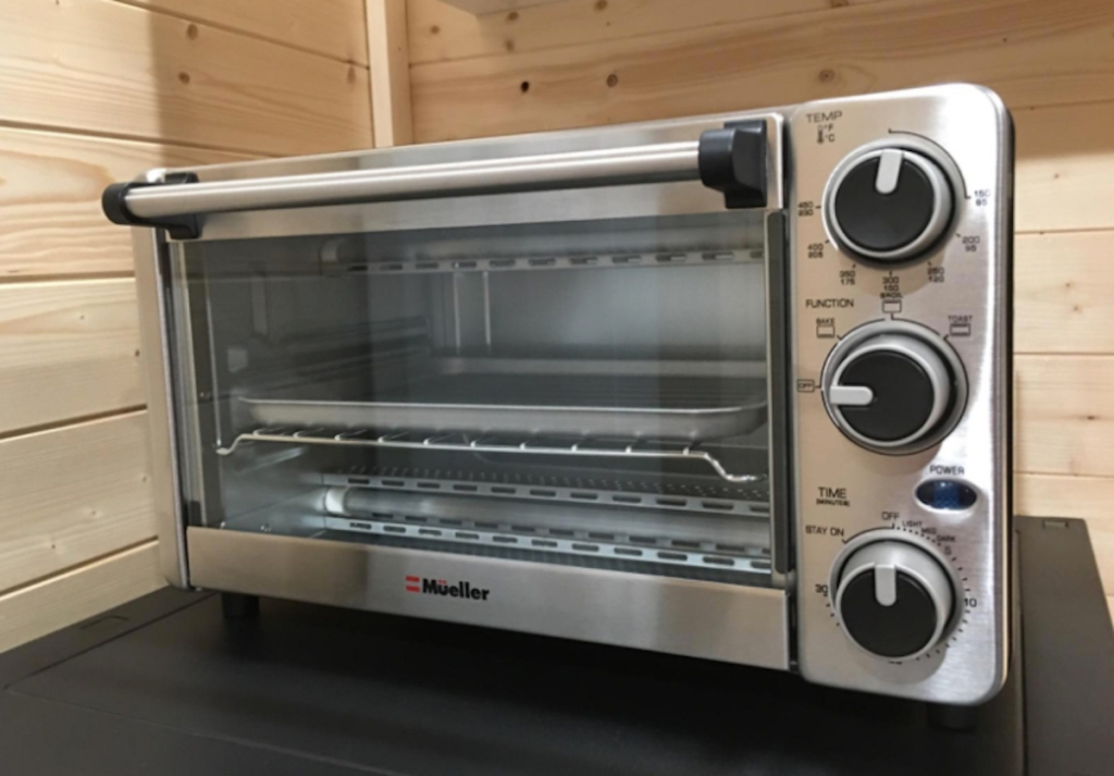 close up of stainless steel toaster oven on kitchen countertop