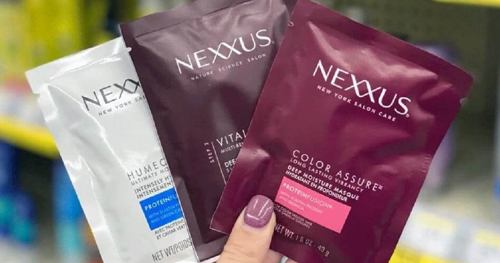 Nexxus Hair Masques fanned in hand