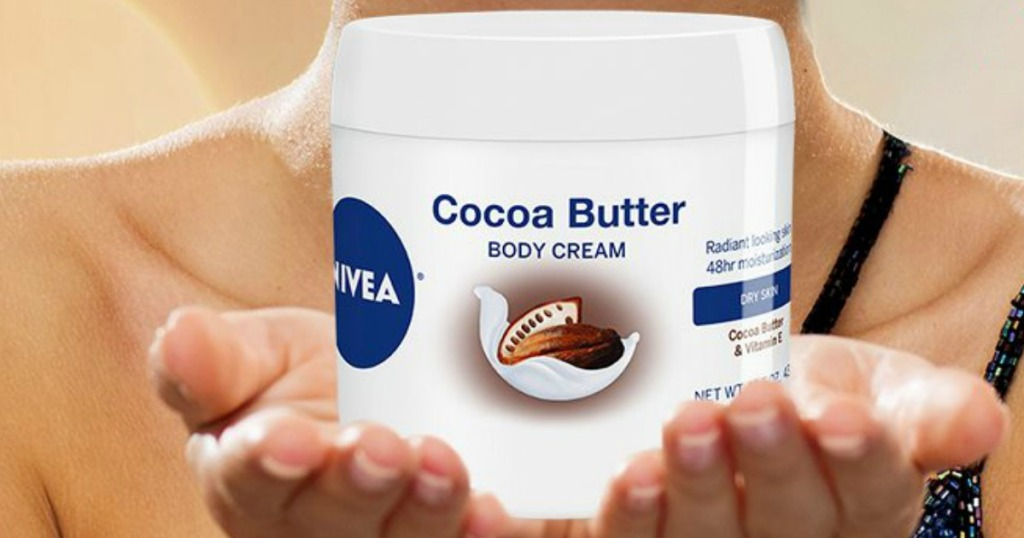 hands holding Nivea cocoa butter
