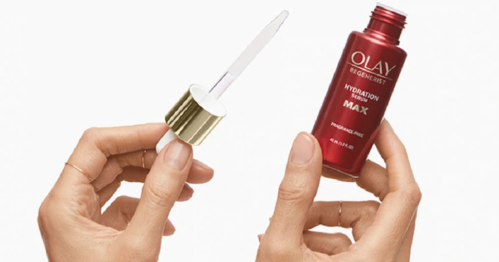 woman's hand holding bottle and dropper for olay serum