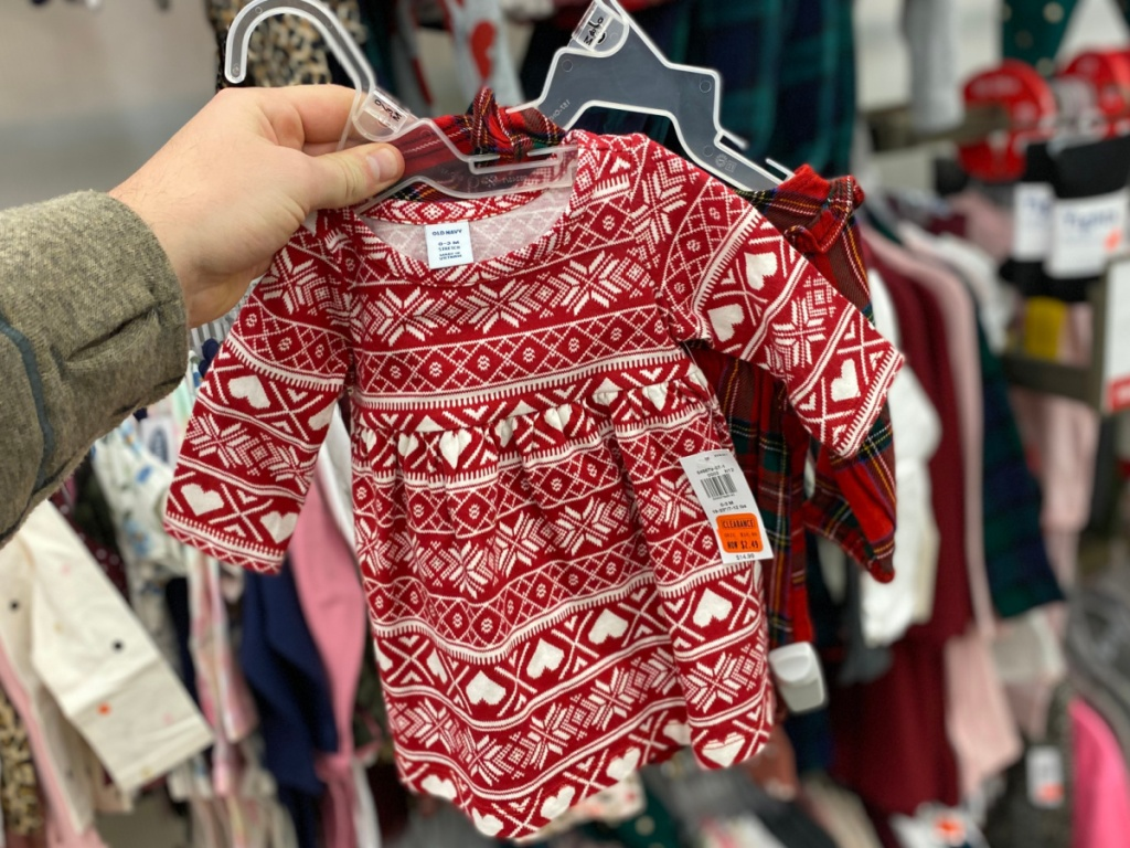 hand holding old navy baby dresses
