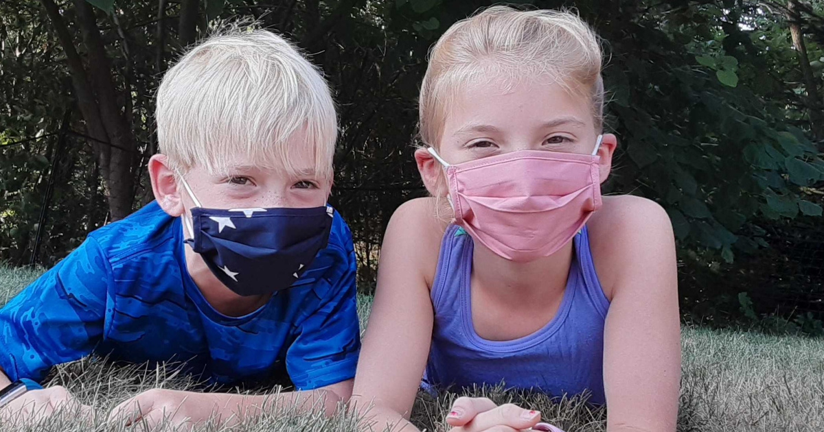 Two kids wearing Old Navy face masks