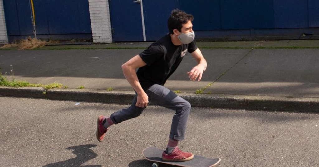 Man skateboarding with Outdoor Research Masks Great for athletes