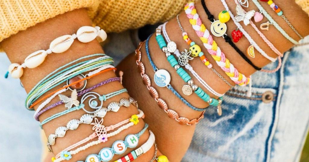 woman wearing multiple colored bracelets