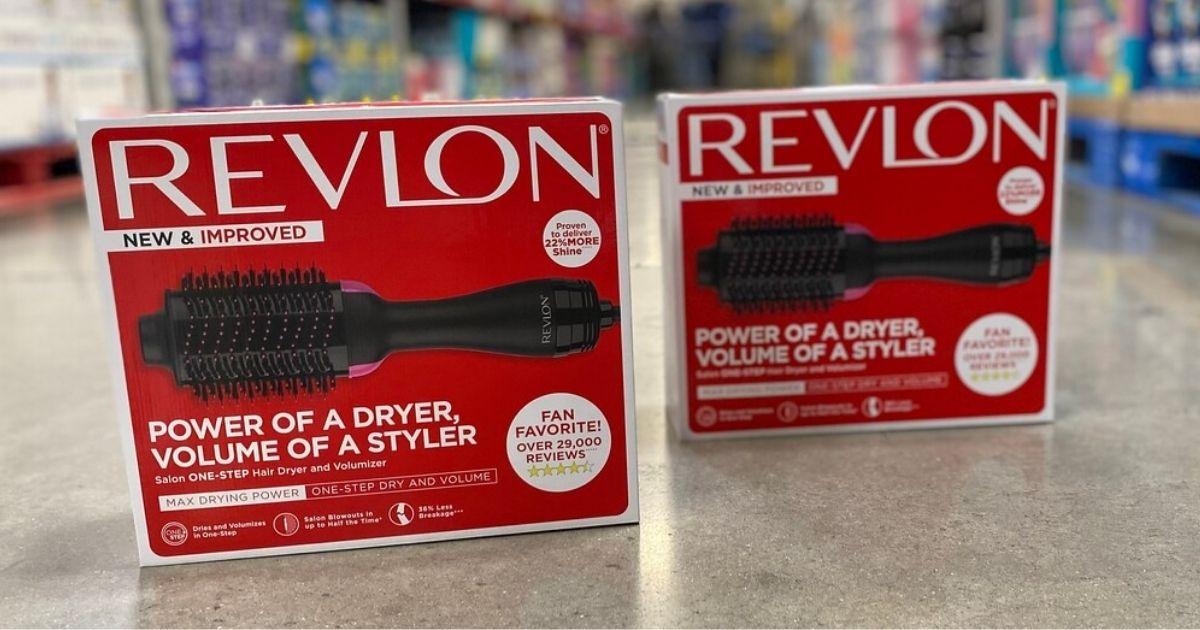 2 Revlon One-Step Hair Dryer & Volumizers in packaging on club floor