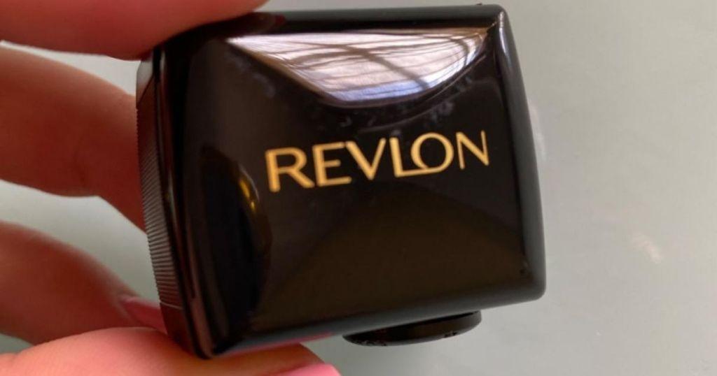 hand holding a Revlon Sharpener