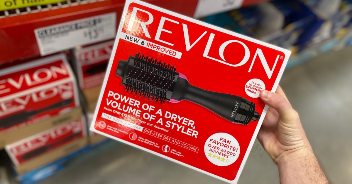 Revlon hair volumizer in hand near in-store display