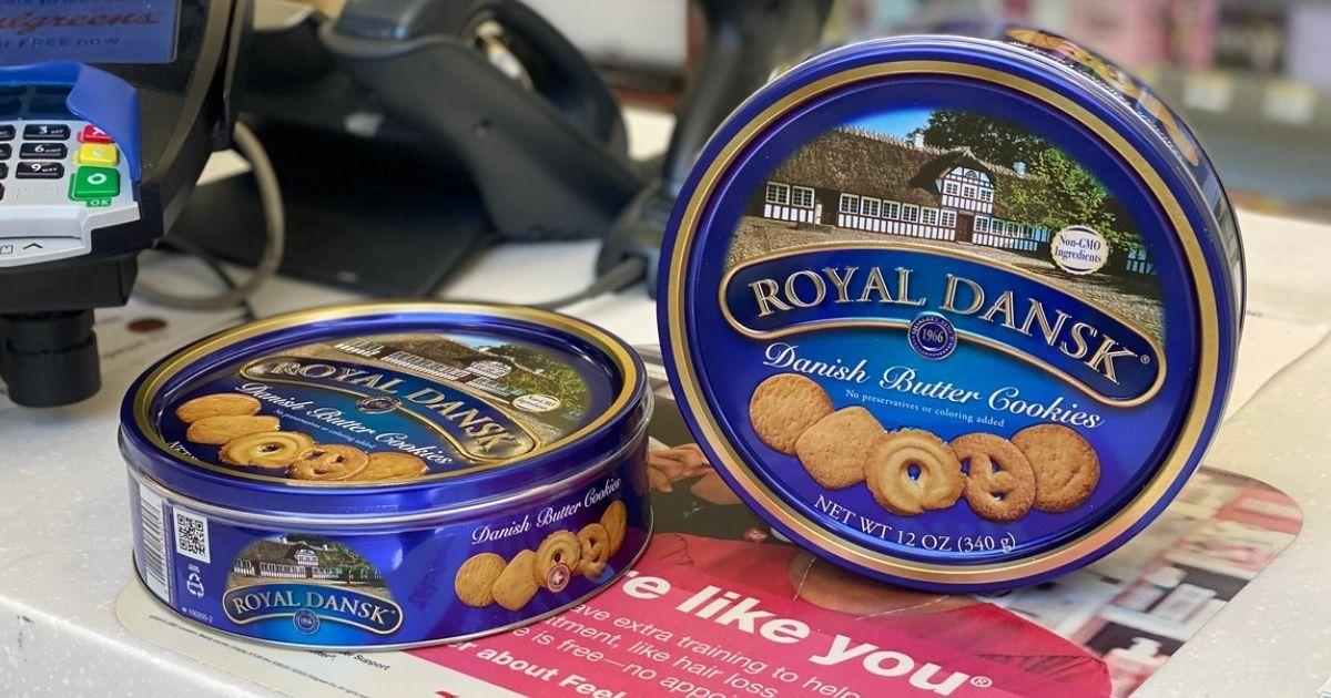 two tins of Royal Dansk Cookies on a Walgreens store counter