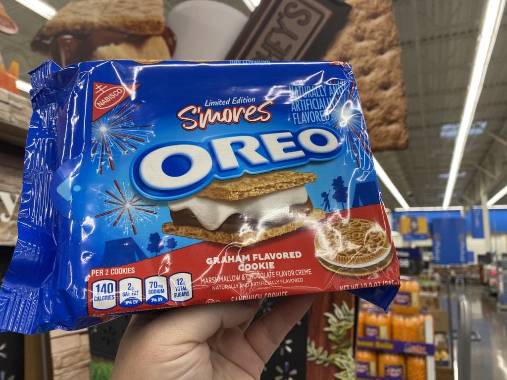 S'Mores Oreo in front of smores sign