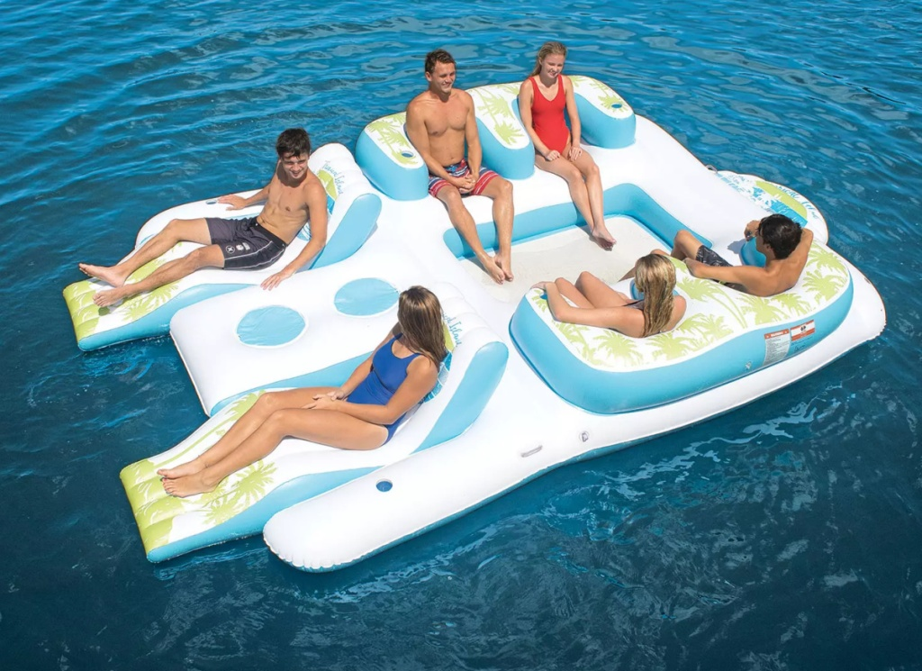 Family laying on a large inflatable island