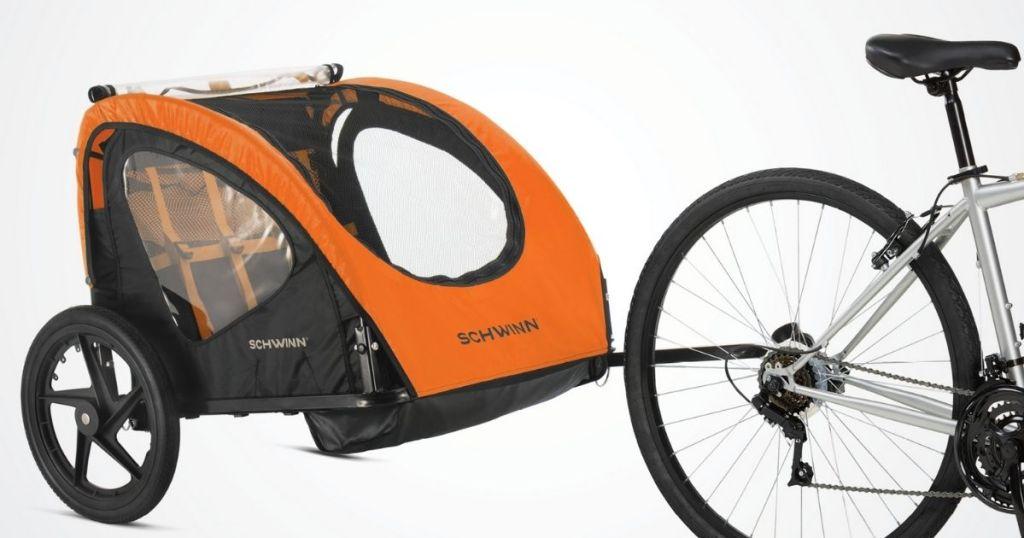 orange Schwinn Bike Trailer hooked to bike