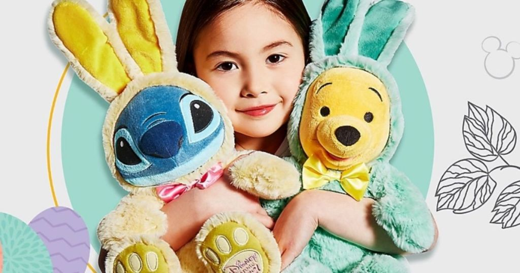 Little girl holding Easter Stitch and Winnie The Pooh