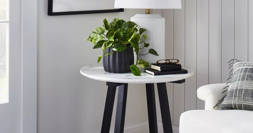 marble accent table with black legs