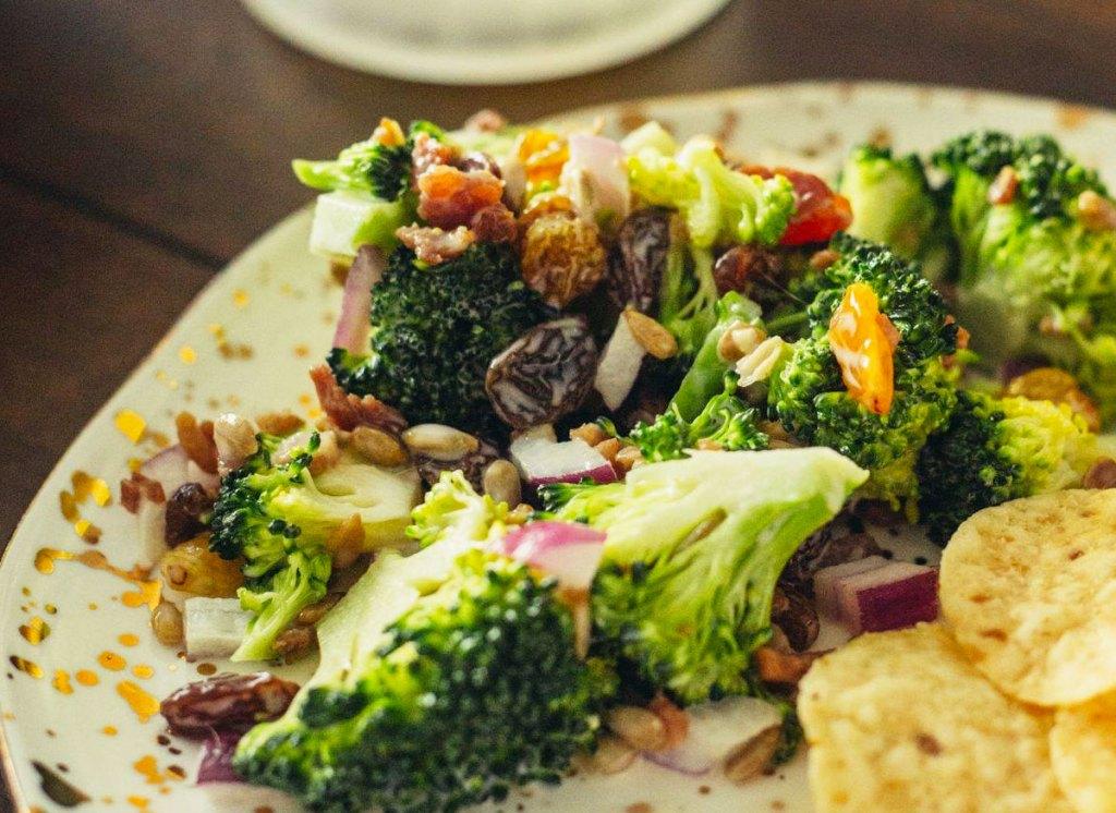 raisins sprinkled on top of a salad
