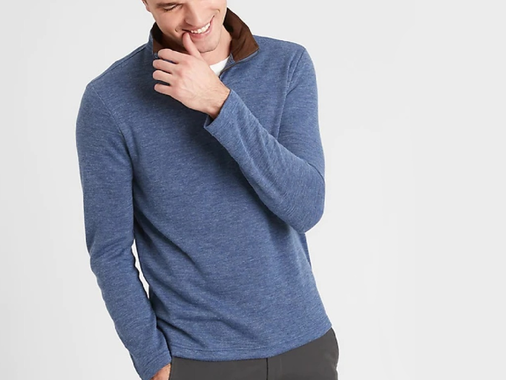 Man wearing a blue pullover