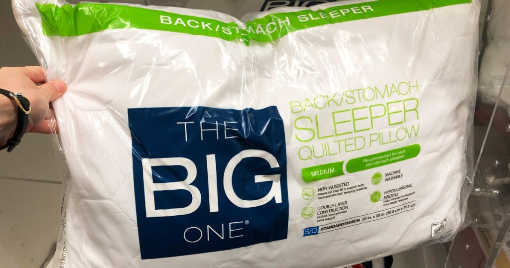 person holding the big one pillow in stores