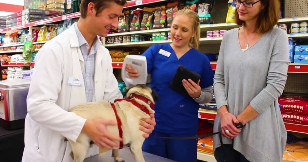people with dog at Tractor Supply Co PetVet Clinic