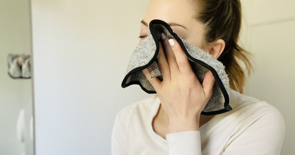 woman wiping her face with a cloth