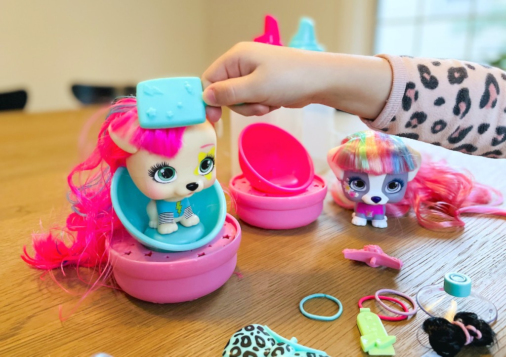 hand brushing vip pet dolls hair on table