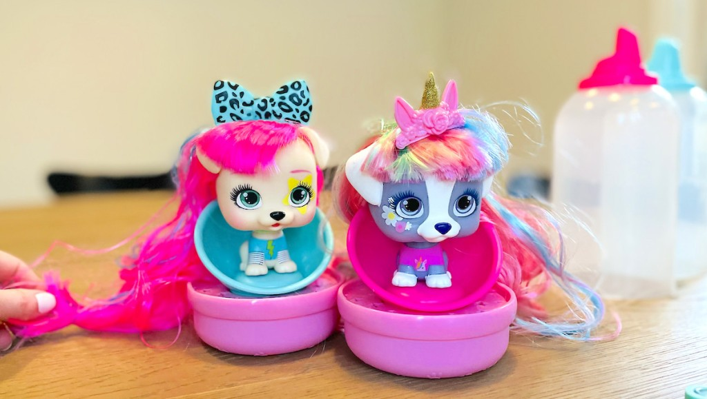 two VIP pet dolls sitting on table