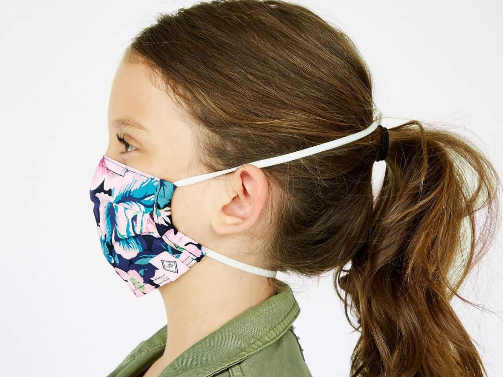 little girl wearing a pleated vera bradley face mask