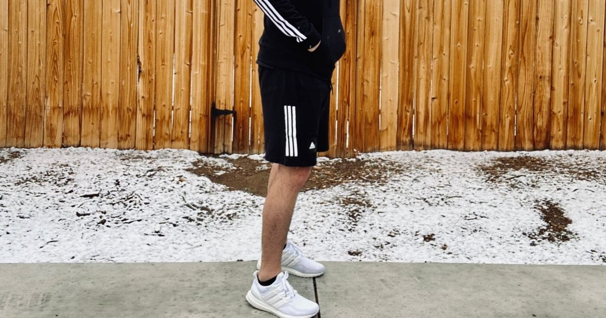 person wearing adidas shorts