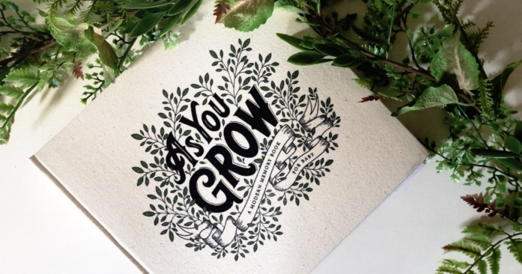 modern baby book with greenery