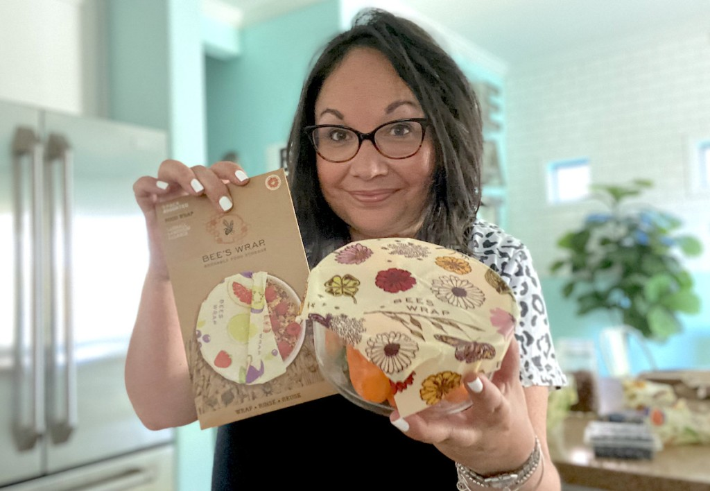 woman holding package and bowl with bee's wraps