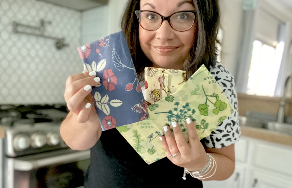 woman holding various styles of bee's wraps
