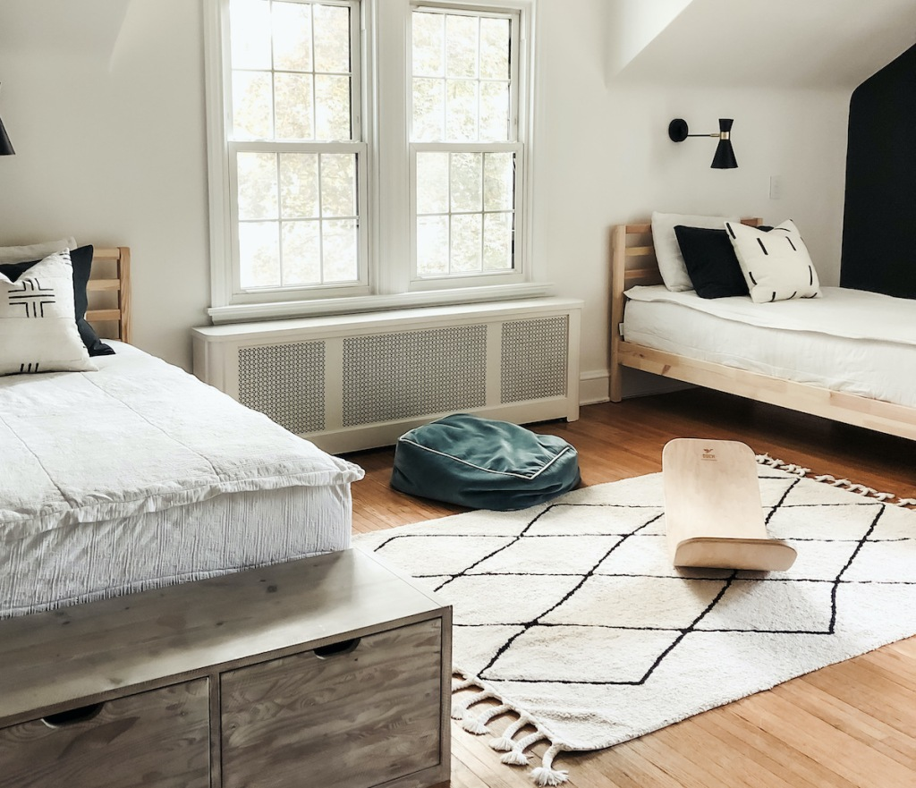 boys room with two beds and rug home decor ideas