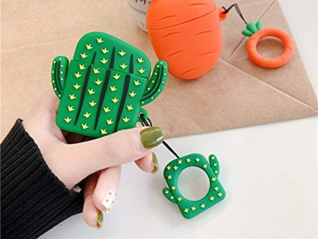 holding an Airpods case shaped like a cactus