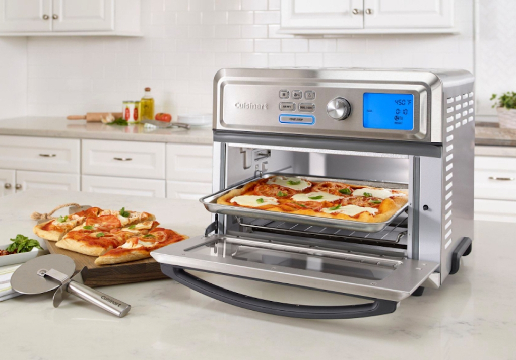 stainless steel toaster oven sitting in white kitchen