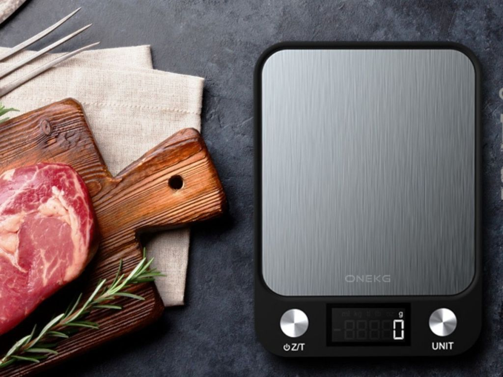 digital scale with cutting board and slab of meat next to it