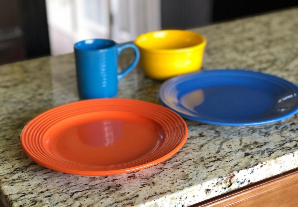 colorful dishes on granite countertop