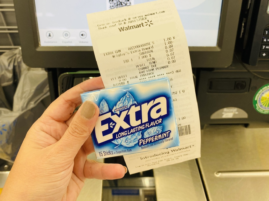 extra peppermint gum with receipt in hand