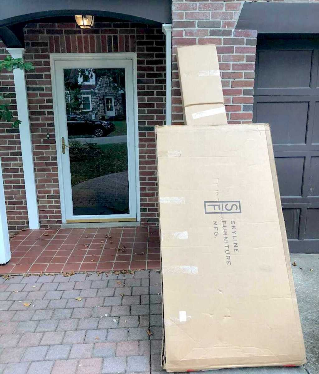 large boxes delivered to front porch outside