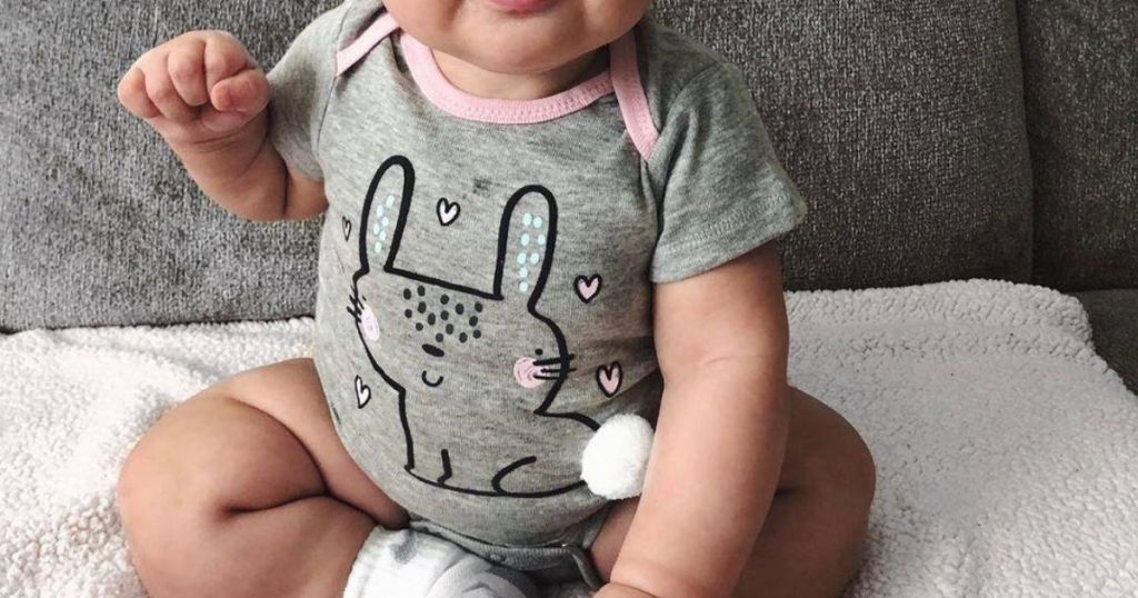 baby wearing gray and pink bunny onesie
