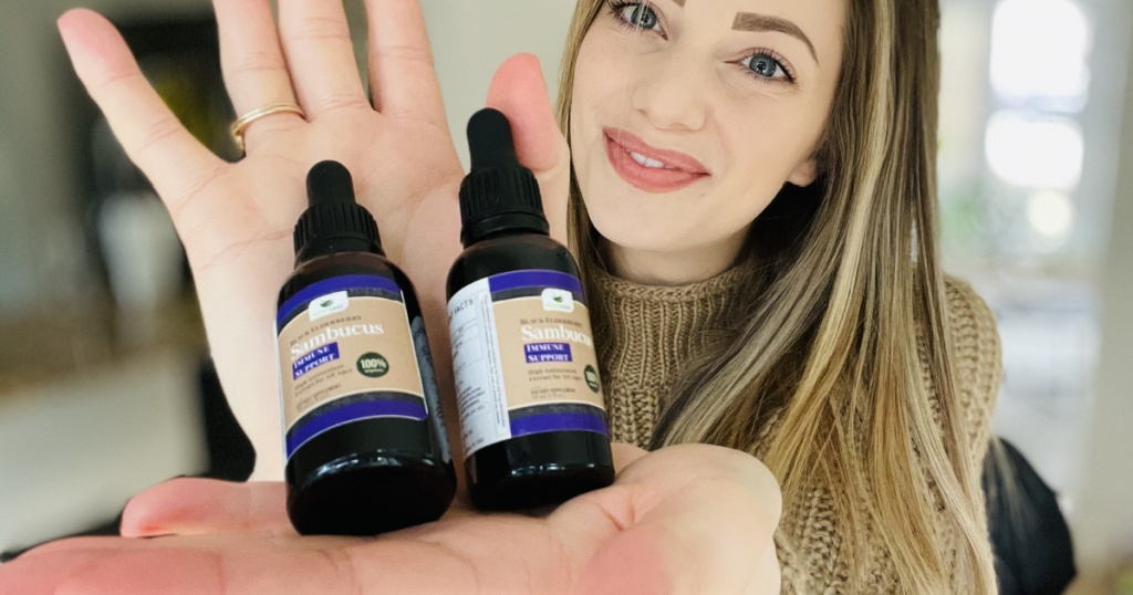 herbaleaf elderberry syrup in womans hand