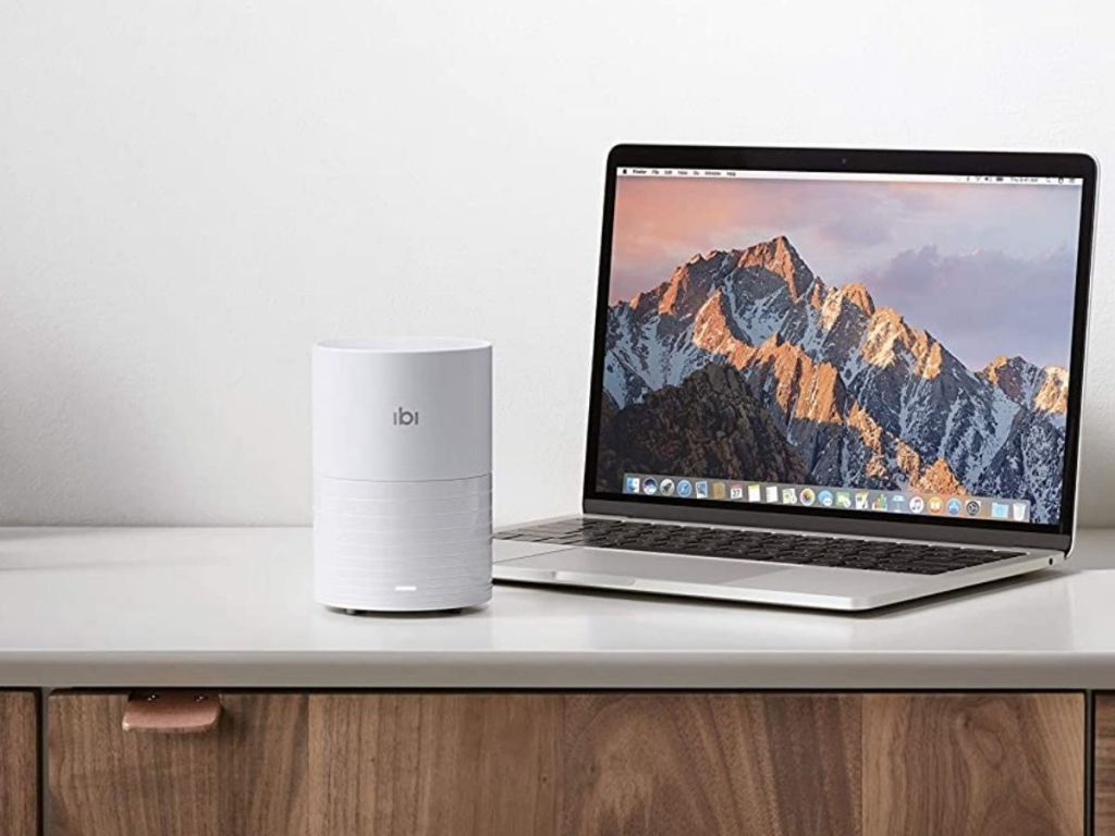 ibi - The Smart Photo Manager with Wi-Fi next to a laptop