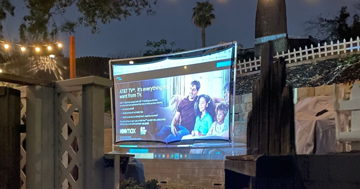projector screen displaying an ad