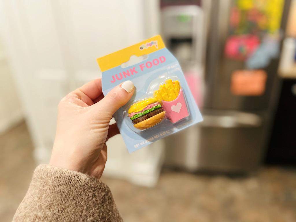 holding junk food lip balm set