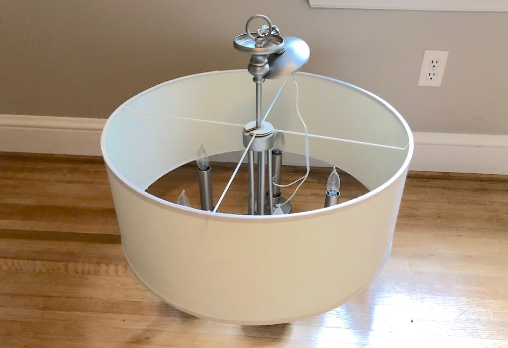 large drum shaped lighting fixture sitting on wood floor home decor ideas