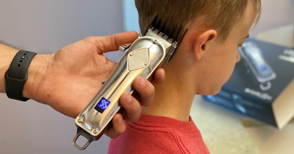 limural hair clippers on little boys head