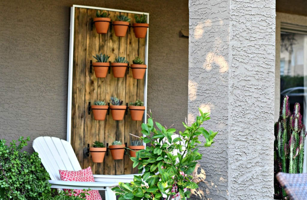 wall hanging with terra cotta pots to hold succulents