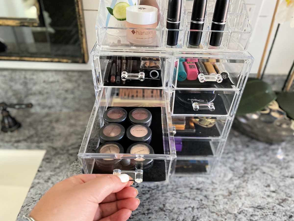 makeup organizer with black lined drawers