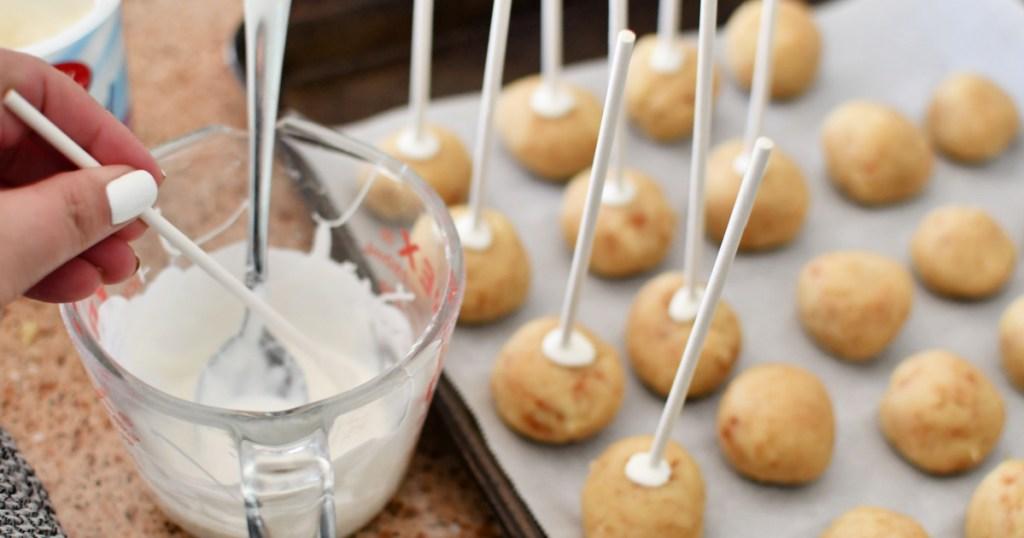 placing balls on a cookie sheet pan