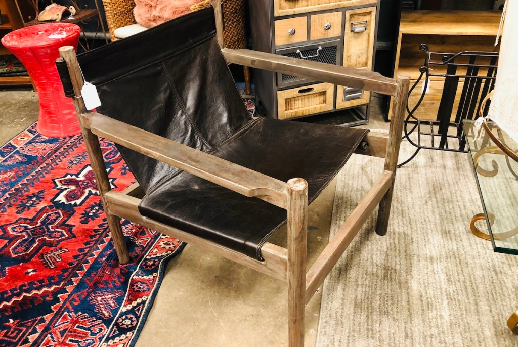 modern sling chair sitting in store with tag